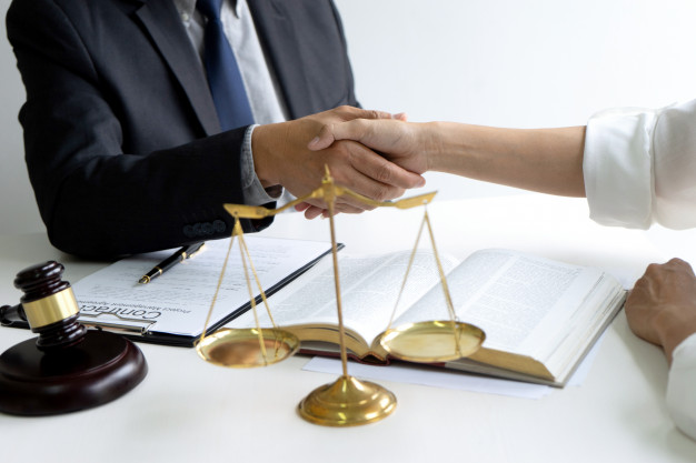 lawyer-judge-with-gavel-balance-handshake_93025-219