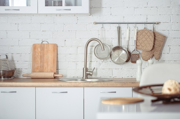modern-stylish-scandinavian-kitchen-interior-with-kitchen-accessories-bright-white-kitchen-with-household-items_169016-4791
